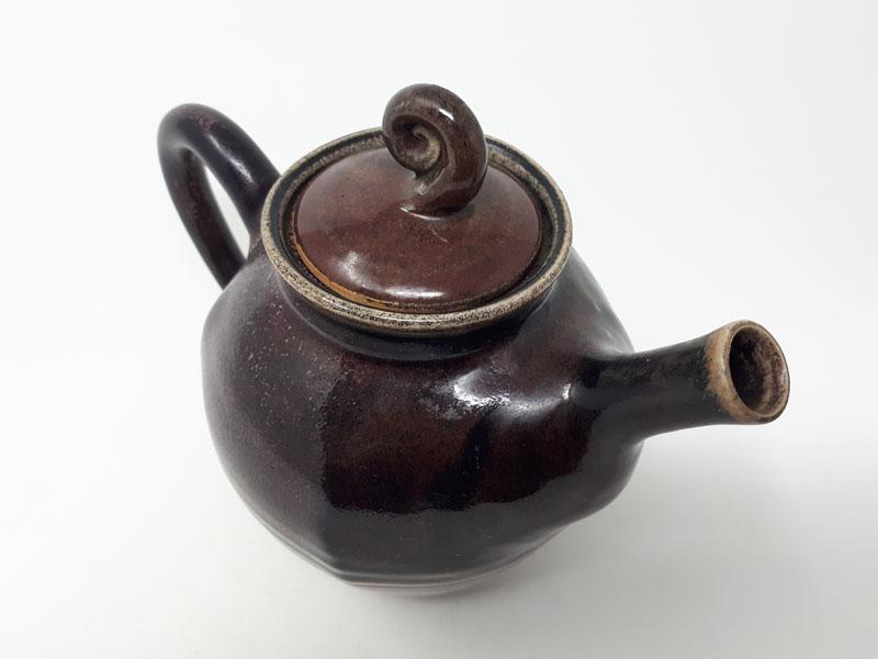 Copper red teapot