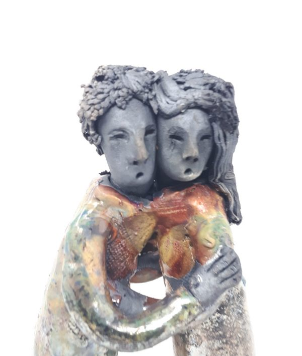 Embracing couple ceramics